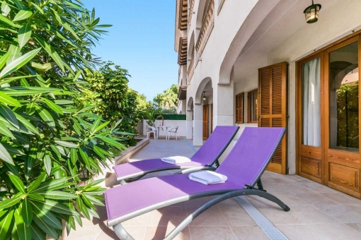 Comfortable veranda with sun loungers.